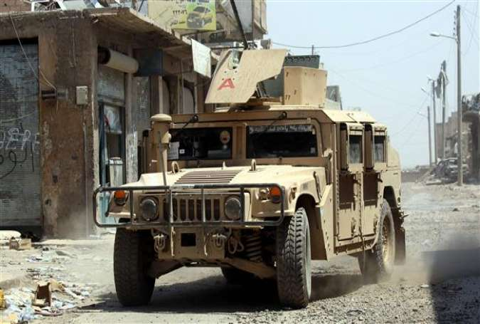 A US-made military vehicle from the Syrian Democratic Forces (SDF) drives in the northern Syrian city of Raqqah on August 15, 2017. (Photo by AFP)