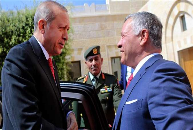 A handout picture released by the Jordanian Royal Palace on August 21, 2017 shows Jordanian King Abdullah II (R) greeting Turkish President Recep Tayyip Erdogan at the royal palace in Amman. (Photos by AFP)