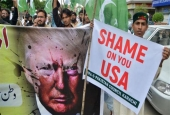 The supporters of the Defense of Pakistan Council, a coalition of around 40 religious and political parties, carry banners during a protest against US President Donald Trump, in Karachi, on August 25, 2017. (Photo by AFP)
