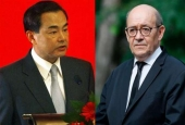 French Foreign Minister Jean-Yves Le Drian (R) and Chinese Foreign Minister Wang Yi. (combo of file photos)