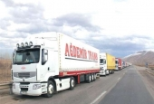 A long line of Turkish trucks are waiting on a road in the Iranian city of Maku