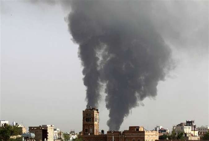 This file photo taken on July 07, 2015 shows smoke billowing following Saudi airstrikes in the Yemeni capital Sana'a. (Photo by AFP)