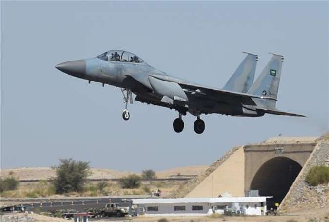 The photo shows a Saudi F-15 fighter jet landing at the Khamis Mushayt military airbase on November 16, 2015. (By AFP)