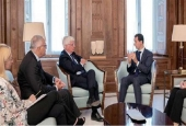 Syrian President Bashar al-Assad (R) speaks with Mario Romani, a member of Italy's Senate of the Republic, in the Syrian capital, Damascus, September 17, 2017. (Photo by SANA)