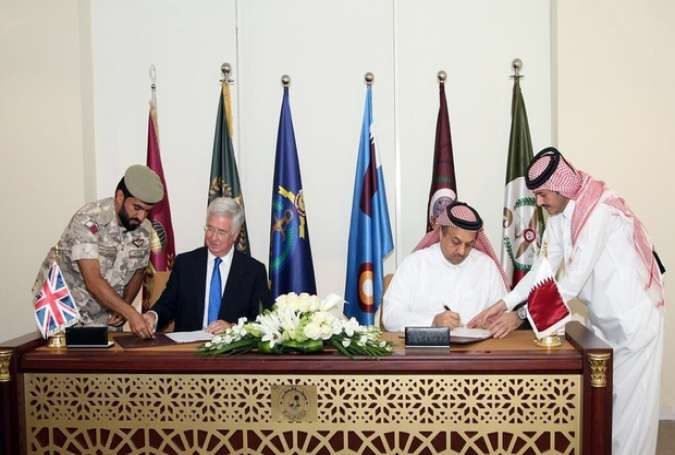 Qatar and Britain signing the Eurofighter Typhoon jets deal