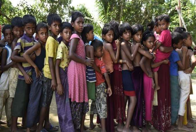 Rohingya refugee children wait for medical treatment at a refugee camp between Myanmar and Bangladesh in the Gumdhum district. (Photo by AFP)