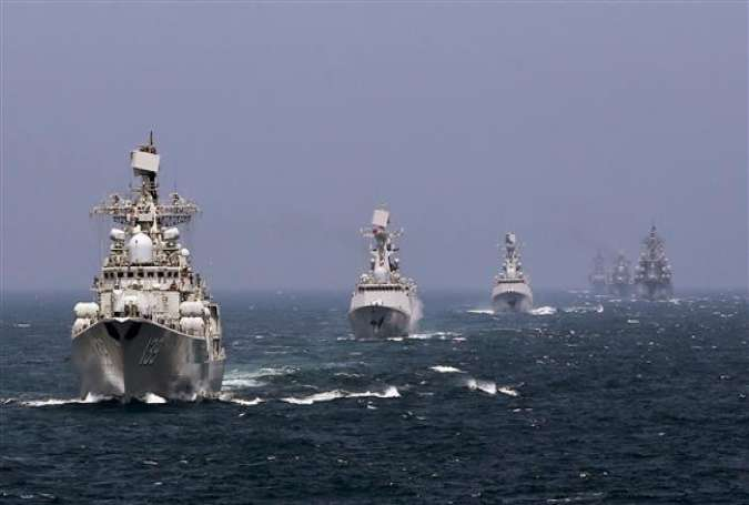 This file photo shows Chinese and Russian warships during naval drills.(Via Reuters)