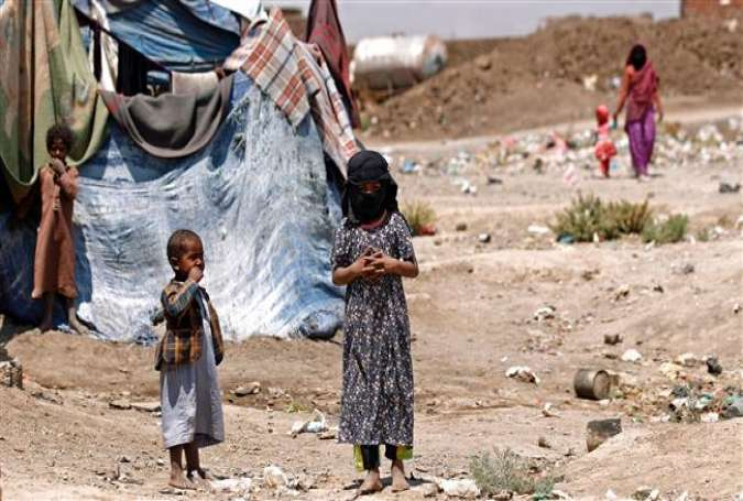 Displaced Yemeni children stand outside a make-shift shelter at a camp for internally displaced persons (IDPs) on the outskirts of Sana'a, Yemen, April 15, 2017. (Photo by AFP)