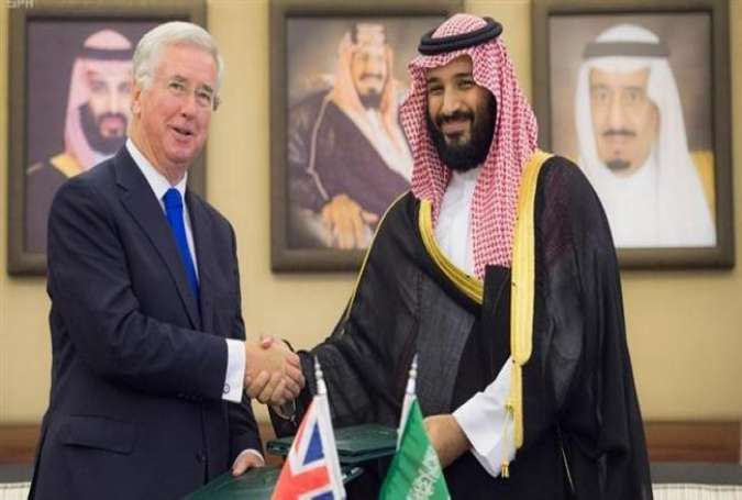 Saudi Crown Prince Mohammed bin Salman, right, shakes hands with British Defense Secretary Michael Fallon after signing agreements in Jeddah, Saudi Arabia, September 19, 2017. (Saudi Press Agency/handout via Reuters)