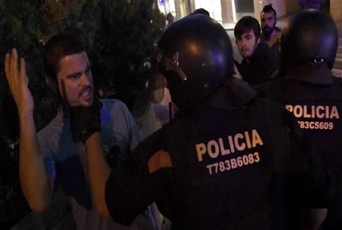 This file photo shows pro-independence protesters facing off with police officers in Catalonia.