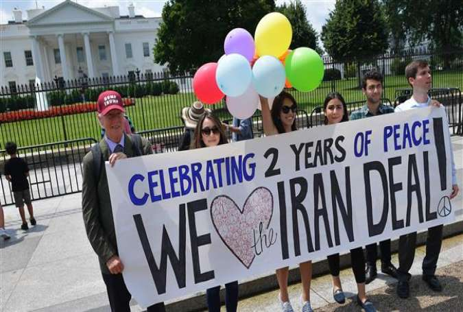 Activists take part in a rally to commemorate the nuclear deal with Iran in front of the White House, Washington, DC.jpg