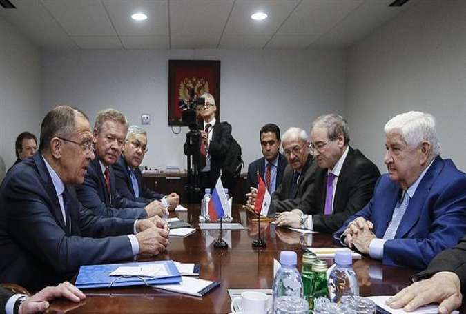 Syrian Foreign Minister Walid Muallem (R) meets with his Russian counterpart, Sergei Lavrov, in New York, September 22, 2017.