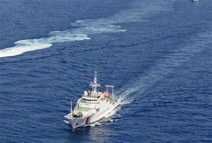 A Chinese coast guard vessel is seen near the disputed islands known as Senkaku in Japan and Diaoyu in China, in the East China Sea. (File photo by AFP)