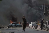 Afghan security force member stands at the site of a car bomb attack in Kabul, Afghanistan.jpg