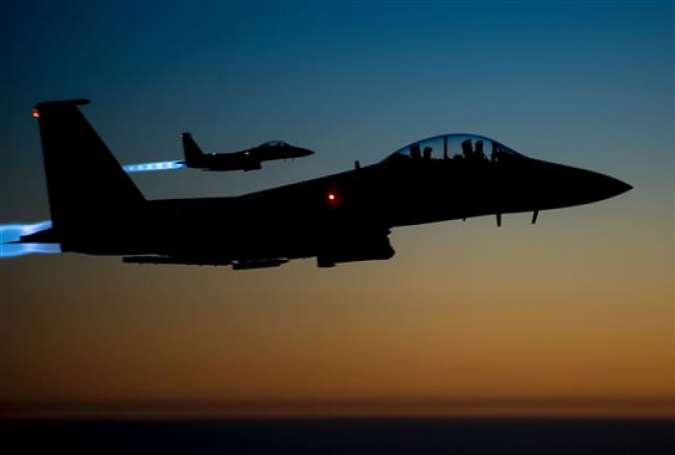 This file photo taken by the US Air Forces Central Command shows a pair of US Air Force F-15E Strike Eagles flying over northern Iraq early in the morning of September 23, 2014 after conducting airstrikes in Syria. (Photo by AFP)