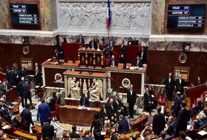 Boards show the results of the vote after French lawmakers in the lower house of parliament in Paris voted on a new counterterrorism law designed to end the country