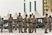 The file photo shows Saudi policemen standing guard in the capital Riyadh.