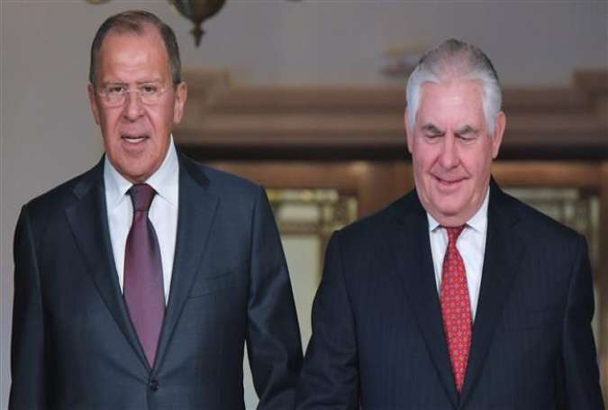 This photo taken on May 10, 2017 shows Russian Foreign Minister Sergei Lavrov (L) and US Secretary of State Rex Tillerson (R) arriving for photos in the Treaty Room of the State Department in Washington, DC. (By AFP)
