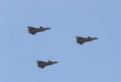 Chinese J-20 stealth fighter jets fly past during a military parade at the Zhurihe training base in China