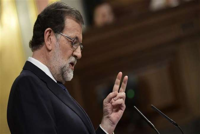 Spanish Prime Minister Mariano Rajoy gestures as he speaks at the Spanish parliament in Madrid on October 11, 2017. (Photo by AFP)