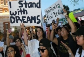 "Immigrants and supporters chant outside the New York-New York Hotel & Casino on the Las Vegas Strip during a ""We Rise for the Dream"" rally to oppose US President Donald Trump. (Photo by AFP)"