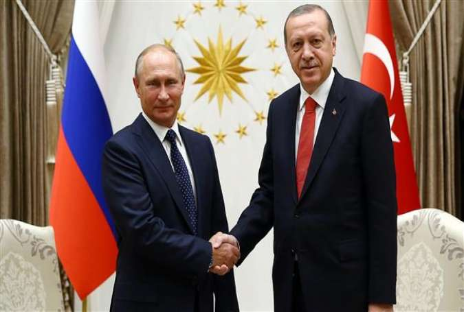 A handout picture released by the Turkish Presidential Press Office and taken on September 28, 2017 shows Russian President Vladimir Putin (L) shaking hands with Turkish President Recep Tayyip Erdogan at the Presidential Complex in Ankara during an official visit. (Via AFP)