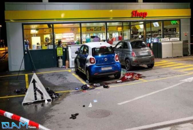 This image taken from online social media purportedly shows the scene where a teen axe attacker was shot outside a petrol station after injuring several people in the small Swiss town of Flums on October 22, 2017.
