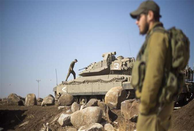 Israeli soldiers next to their tanks in the Israeli-occupied Golan Heights.jpg