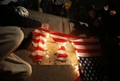 UK anti-govt. protesters burn US flag.jpg