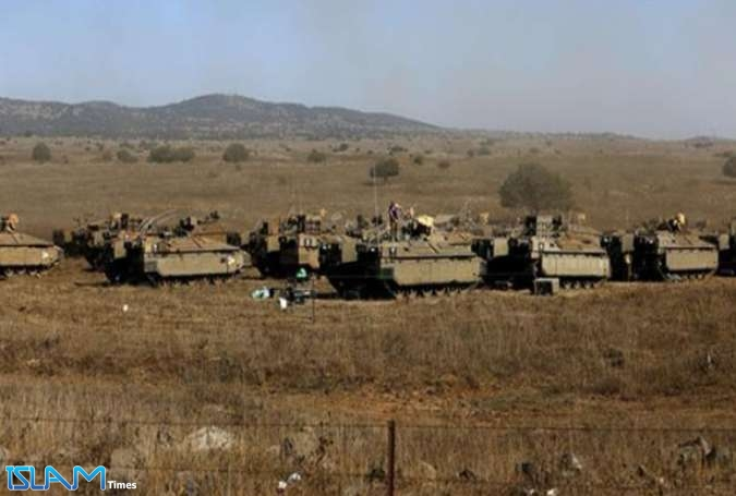 Israeli soldiers stand atop armored personnel carriers stationed in the Israeli-occupied Golan Heights on August 21, 2015