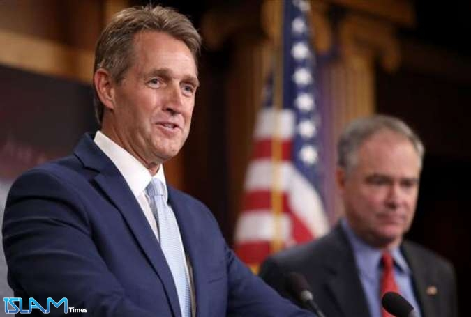 File photo of Sen. Jeff Flake (L)