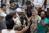 People recover bodies of two children under rubble of a house destroyed by a Saudi-led coalition's airstrike in Sanaa, Yemen