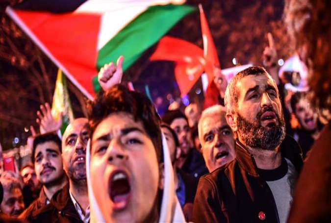 Protesters chant slogans and wave Palestinian flags during a demonstration against the US and Israel in front of the US consulate in Istanbul, Turkey.jpg