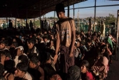 Rohingya Muslim refugees queue for relief supplies in the Kutupalong refugee camp in Cox