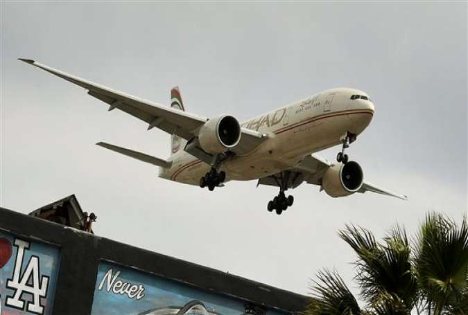 This file photo taken on March 22, 2017 shows an Etihad Airlines plane from Abu Dhabi preparing to land at Los Angeles International Airport in Los Angeles, California. (Photo by AFP)