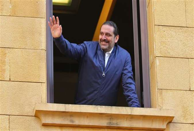 Lebanese Prime Minister Saad Hariri greets his supporters on his arrival at his home in Beirut, Lebanon, on November 22, 2017. (Photo by AFP)