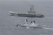 Russian warship escorted away from UK territorial waters