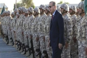 Turkey's President Recep Tayyip Erdogan visits Turkish troops at the Qatari-Turkish Armed Forces Land Command Base in Doha on November 15, 2017. (Photo by AP)