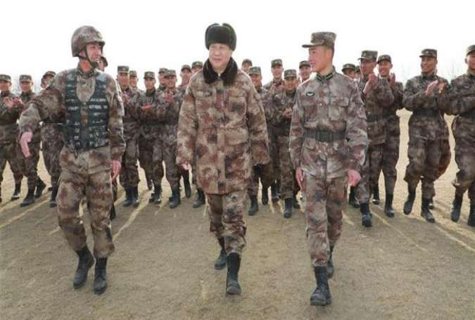 Chinese President Xi Jinping (C, front) talks with officers and soldiers during an inspection of a division of the People's Liberation Army (PLA) in the Central Theater Command, in northern Hebei Province, China, January 3, 2018.