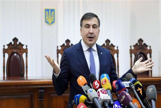 Former Georgian President Mikheil Saakashvili gestures as he speaks to the media prior to the start of his appeal hearing at a courthouse in Kiev, Ukraine, January 3, 2018. (Photo by AFP)