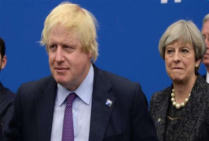 British Secretary for Foreign Affairs Boris Johnson (L) and British Prime minister Theresa May (AFP file photo)