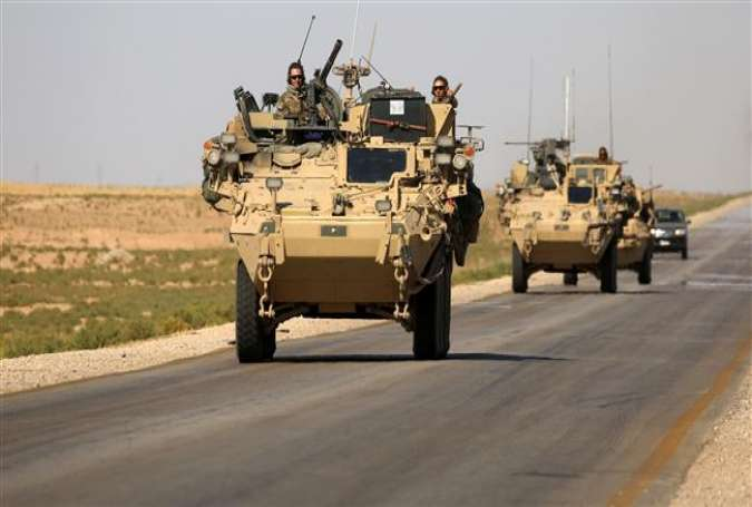US troops on a road near the northern Syrian village of Ain Issa.jpg