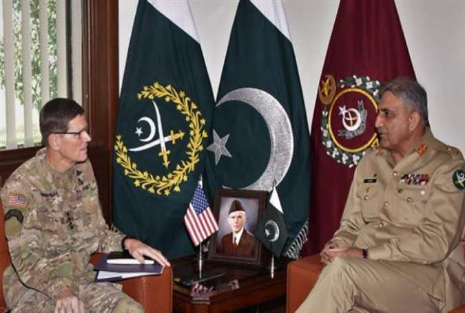 General Qamar Javed Bajwa, Pakistan Army Chief talking to US Central Command Chief General Joseph Votel..jpg