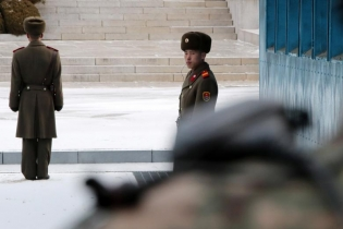North Korean soldiers stand guard during a high-level talks at the truce village of Panmunjom in the demilitarized zone separating the two Koreas, South Korea.