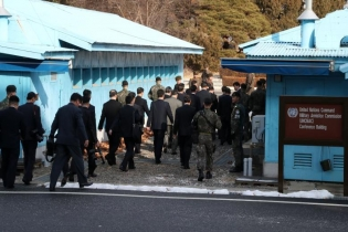 North Korean delegation led by Ri Son Gwon, Chairman of the Committee for the Peaceful Reunification of the Country (CPRC) of DPRK, cross the concrete border as they leave after their meeting at the truce village of Panmunjom in the demilitarized zone se