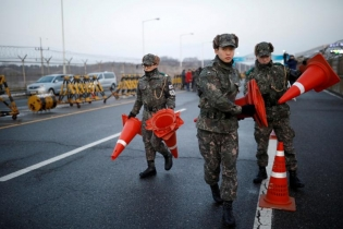 South Korean soldiers place traffic cones at a checkpoint on the Grand Unification Bridge that leads to the truce village of Panmunjom, just south of the demilitarized zone separating the two Koreans, in Paju, South Korea.