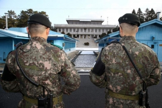 South Korean soldiers stand guard at the truce village of Panmunjom in the demilitarized zone separating the two Koreas, South Korea.