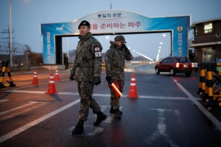 South Korean soldiers stand guard at a check point on the Grand Unification Bridge that leads to the truce village of Panmunjom, just south of the demilitarized zone separating the two Koreans, in Paju, South Korea.