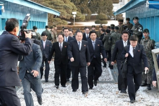 The North Korean delegation led by Ri Son Gwon, Chairman of the Committee for the Peaceful Reunification of the Country (CPRC) of DPRK, cross the concrete border to attend a meeting at the truce village of Panmunjom in the demilitarized zone separating t