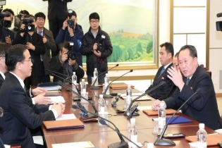 Head of the North Korean delegation, Ri Son Gwon talks with South Korean counterpart Cho Myoung-gyon during their meeting at the truce village of Panmunjom in the demilitarized zone separating the two Koreas, South Korea.